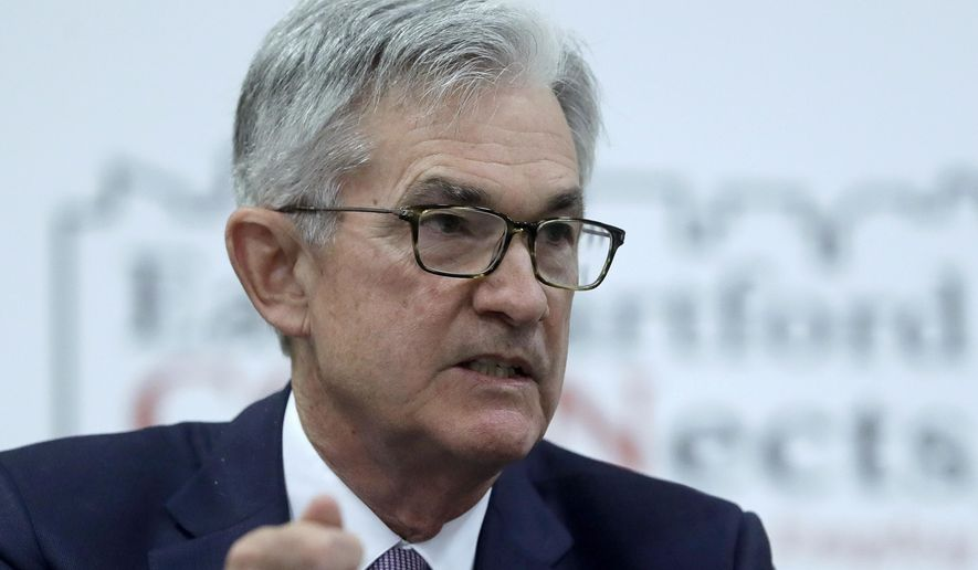 In this Nov. 25, 2019, file photo Federal Reserve Board Chair Jerome Powell addresses a round table discussion during a visit to Silver Lane Elementary School, in East Hartford, Conn. On Wednesday, Dec. 11, the Federal Reserve issues a statement and economic projections, followed by a news conference with Powell. (AP Photo/Steven Senne)