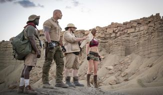 """This image released by Sony shows Kevin Hart, from left, Dwayne Johnson, Jack Black and Karen Gillan in a scene from """"Jumanji: The Next Level."""" (Hiram Garcia/Sony via AP)"""