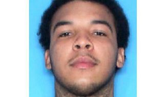 This undated photo provided by the New Orleans Police Department shows Stafford Starks. Police Chief Shaun Ferguson identified one suspect as Starks, 21. He was in custody after his arrest in St. Mary. Charges he faces include eight counts of attempted second-degree murder. (New Orleans Police Department via AP)