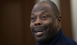 "Georgetown head coach Patrick Ewing speaks during an NCAA college basketball media availability, Wednesday, Dec. 11, 2019, in Washington.  It was hard not to do a double-take when Georgetown basketball coach Patrick Ewing replied to a question Wednesday about whether his full roster will be available for the team's next game, against Syracuse, by saying, ""As of now, yes."" That'll be the Hoyas' first home contest since legal matters involving players came to light. (AP Photo/Nick Wass) ** FILE **"