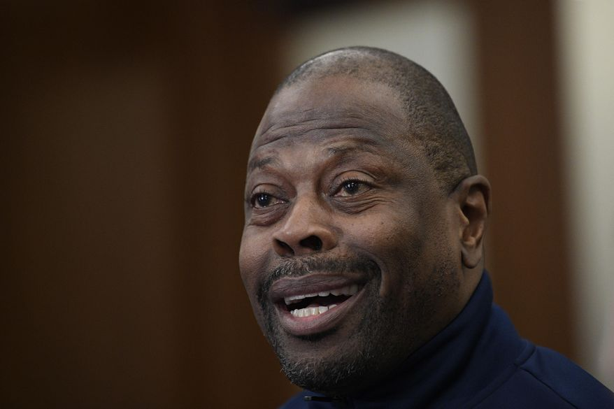 """Georgetown head coach Patrick Ewing speaks during an NCAA college basketball media availability, Wednesday, Dec. 11, 2019, in Washington.  It was hard not to do a double-take when Georgetown basketball coach Patrick Ewing replied to a question Wednesday about whether his full roster will be available for the team's next game, against Syracuse, by saying, """"As of now, yes."""" That'll be the Hoyas' first home contest since legal matters involving players came to light. (AP Photo/Nick Wass) ** FILE **"""