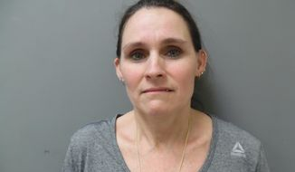 In this Dec. 10, 2019 booking photo provided by the Vermont State Police, Angela Auclair, of Bristol, Vt., is seen after she was arrested on suspicion of aiding in the commission of a felony (first-degree murder) and obstruction of justice arising from the July 11, 2019 fatal shooting of her husband, David Auclair in Hinesburg, Vt. Auclair is being held without bail and is scheduled to be arraigned Wednesday, Dec. 11. (Vermont State Police via AP)