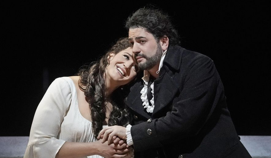"This Nov. 25, 2019 photo released by the Metropolitan Opera, tenor Yusif Eyvazov, right, appears with soprano Lise Davidsen in a scene from Tchaikovsky's ""The Queen of Spades"" at the Metropolitan Opera in New York. (Ken HowardMetropolitan Opera via AP)"