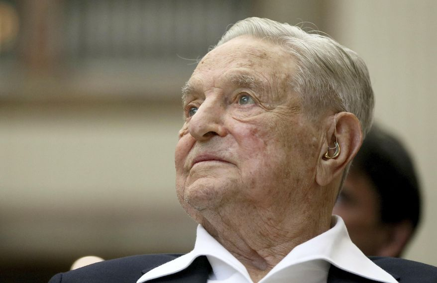George Soros, founder and chairman of the Open Society Foundations, looks before the Joseph A. Schumpeter award ceremony in Vienna, Austria. (AP Photo/Ronald Zak, File)