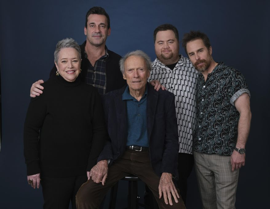 """This Dec. 5, 2019 photo shows director Clint Eastwood, center, posing with cast members, from left, Kathy Bates, Jon Hamm, Paul Walter Hauser and Sam Rockwell during a portrait session to promote their film """"Richard Jewell"""" at the Four Seasons Hotel in Beverly Hills, Calif. (AP Photo/Chris Pizzello)"""