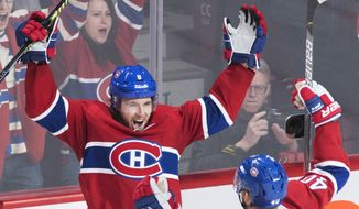 Montreal Canadiens' Ben Chiarot (8) celebrates with teammate Joel Armia after scoring during overtime in an NHL hockey game against the Ottawa Senators, Wednesday, Dec. 11, 2019 in Montreal. (Graham Hughes/The Canadian Press via AP)
