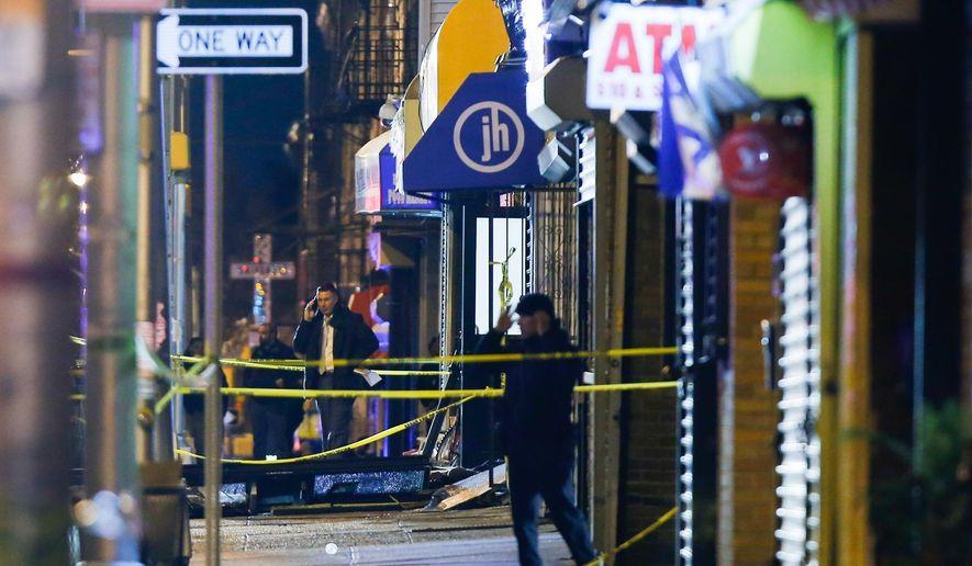 Law enforcement are seen at the scene following reports of gunfire, Tuesday, Dec. 10, 2019, in Jersey City, N.J. AP Photo/Eduardo Munoz Alvarez)