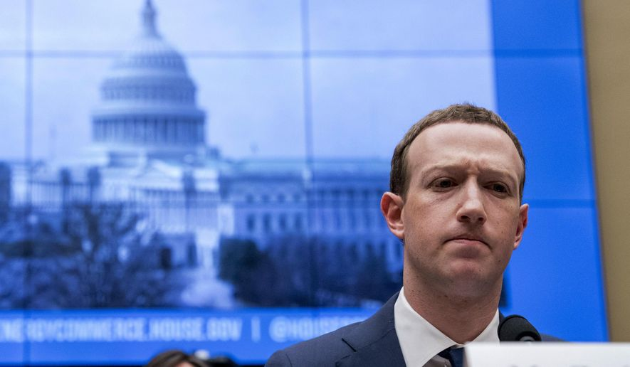 """In this April 11, 2018, file photo, Facebook CEO Mark Zuckerberg pauses while testifying before a House Energy and Commerce hearing on Capitol Hill in Washington about the use of Facebook data to target American voters in the 2016 election and data privacy. A year ago, Shoshana Zuboff dropped an intellectual bomb on the technology industry. In a 700-page book, the Harvard scholar skewered tech giants like Facebook and Google with a damning phrase: """"surveillance capitalism."""" (AP Photo/Andrew Harnik, File)"""