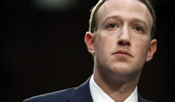 In this Tuesday, April 10, 2018, file photo, Facebook CEO Mark Zuckerberg testifies before a joint hearing of the Commerce and Judiciary Committees on Capitol Hill in Washington, about the use of Facebook data to target American voters in the 2016 election. (AP Photo/Alex Brandon, File)