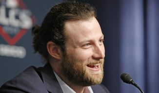 In this Oct. 14, 2019, file photo, Houston Astros starting pitcher Gerrit Cole talks to the media at Yankee Stadium in New York, on an off day during the American League Championship Series between the Astros and the New York Yankees. The New York Yankees landed the biggest prize of the free agent market, adding Gerrit Cole to their rotation with a record $324 million, nine-year contract on Tuesday night, a person familiar with the deal told The Associated Press. The person spoke on condition of anonymity because the agreement had not been announced. (AP Photo/Kathy Willens, File)  **FILE**