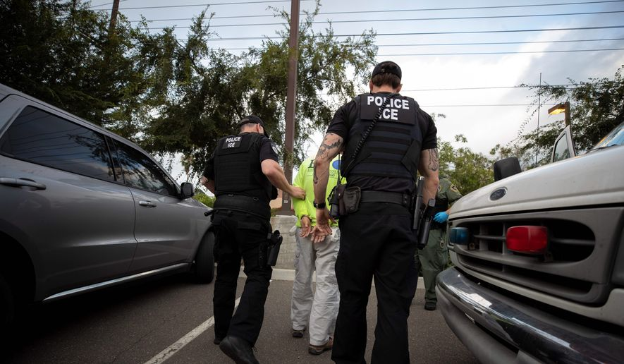 U.S. Immigration and Customs Enforcement's officers are shown in this July 2019 file photo. (Associated Press) **FILE**