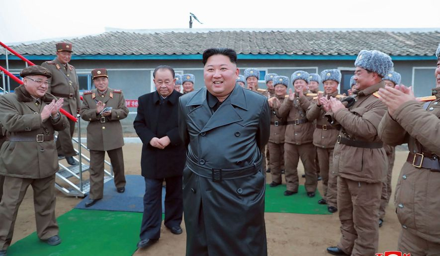"""North Korea, led by Kim Jong-un (center), accused the U.S. on Thursday of engaging in a """"stupid"""" and """"hostile provocation"""" by convening with a U.N. Security Council meeting on the rising threat of escalation posed by Pygongyang's recent military tests. (ASSOCIATED PRESS)"""