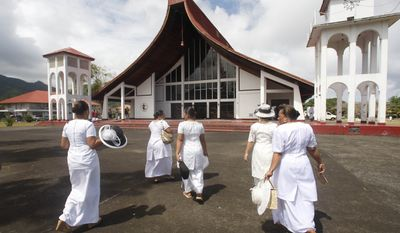 Women attend a National Prayer Service in the village of Kanana Fou in American Samoa, Sunday, Oct. 4, 2009. Families were still coming to terms with the sudden losses, at least 176 died on Samoa, American Samoa and Tonga. (AP Photo/Rick Bowmer)
