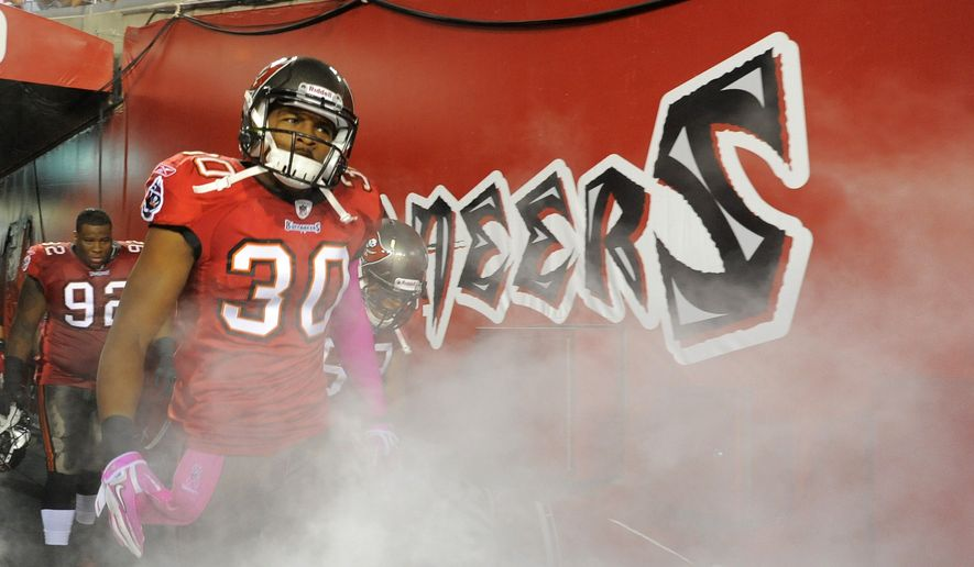Tampa Bay Buccaneers defensive back Devin Holland (30) comes out of the tunnel at the start of NFL football game against the Indianapolis Colts on Monday, Oct. 3, 2011, in Tampa, Fla. (AP Photo/Brian Blanco)