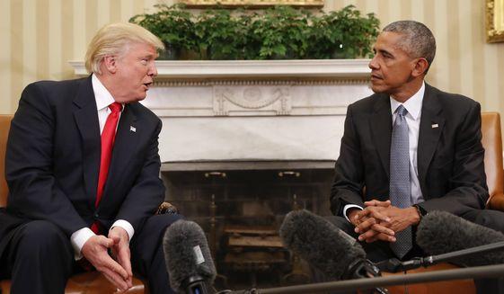 President Barack Obama listens to President-elect Donald Trump speak during their meeting in the Oval Office of the White House in Washington, Thursday, Nov. 10, 2016. (AP Photo/Pablo Martinez Monsivais)