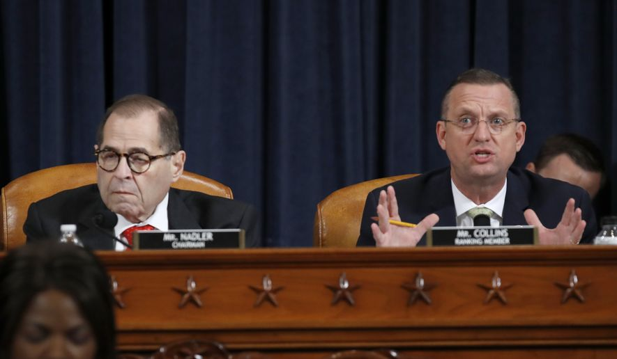 House Judiciary Committee Chairman Rep. Jerrold Nadler, D-N.Y., listens as ranking member Rep. Doug Collins, R-Ga., speaks during a House Judiciary Committee markup of the articles of impeachment against President Donald Trump, on Capitol Hill Thursday, Dec. 12, 2019, in Washington. (AP Photo/Alex Brandon)