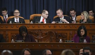 House Judiciary Committee Chairman Rep. Jerrold Nadler, D-N.Y., left, talks with  ranking member Rep. Doug Collins, R-Ga., right, during a House Judiciary Committee markup of the articles of impeachment against President Donald Trump, on Capitol Hill Thursday, Dec. 12, 2019, in Washington.  (Matt McClain/Pool via AP)
