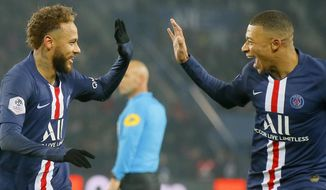 PSG's Neymar, left, celebrates with PSG's Kylian Mbappe after scoring his side's opening goal during the French League One soccer match between PSG and Nantes at the Parc des Princes stadium in Paris, Wednesday, Dec. 4, 2019. The goal was disallowed on a VAR (video assistant referee) decision.(AP Photo/Michel Euler)