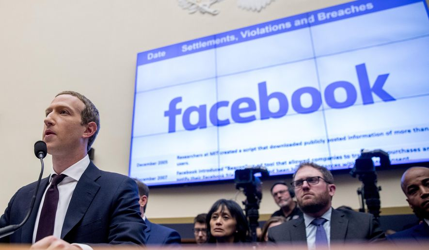 This Oct. 23, 2019, photo shows Facebook CEO Mark Zuckerberg testifying before a House Financial Services Committee hearing on Capitol Hill in Washington. (AP Photo/Andrew Harnik) **FILE**