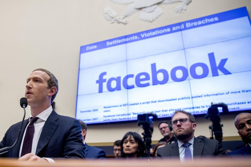 This Oct. 23, 2019, file photo shows Facebook CEO Mark Zuckerberg testifying before a House Financial Services Committee hearing on Capitol Hill in Washington. (AP Photo/Andrew Harnik, File)