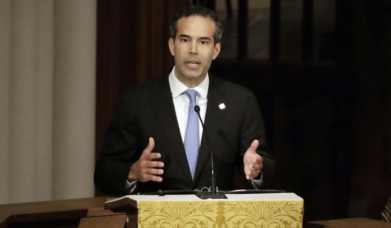 "In this Dec. 6, 2018 file photo, George P. Bush pauses as he gives a eulogy during a funeral for former President George H.W. Bush at St. Martin's Episcopal Church, in Houston. Bush condemned racism in his party Thursday, Dec. 12, 2019 over what he says is now a third instance in Texas this month of ""racist or hateful rhetoric,"" the latest being a Facebook post that he suspects targets his own Hispanic family.  (AP Photo/Mark Humphrey, File)"