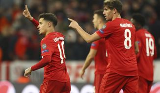 Bayern's Philippe Coutinho, left, celebrates with teammates after scoring his sides third goal during the Champions League group B soccer match between Bayern Munich and Tottenham Hotspur at the Allianz Arena stadium, in Munich, Wednesday, Dec. 11, 2019. (AP Photo/Matthias Schrader)