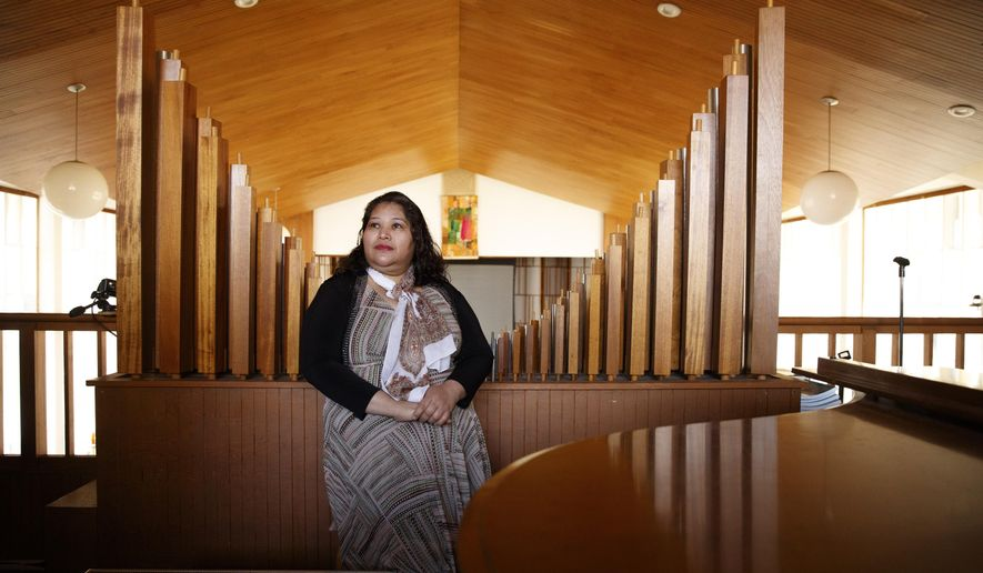 Rosa Gutierrez Lopez, from el Salvador, who a year ago became the first unauthorized immigrant to get refuge inside a religious institution in the Washington area, poses for a portrait at Cedar Lane Unitarian Universalist Church where she has been living in sanctuary for a year due to a deportation order, in Bethesda, Md., Thursday, Dec. 5, 2019. (AP Photo/Jacquelyn Martin)