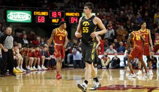 Iowa center Luka Garza (55) walks on the court at the end of an NCAA college basketball game against Iowa State, Thursday, Dec. 12, 2019, in Ames, Iowa. Iowa won 84-68. (AP Photo/Charlie Neibergall)