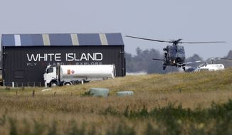 A Navy helicopter returns to Whakatane Airport following the recovery operation to return the victims of the Dec. 9 volcano eruption continues off the coast of Whakatane New Zealand, Friday, Dec. 13, 2019. A team of eight New Zealand military specialists landed on White Island early Friday to retrieve the bodies of victims after the Dec. 9 eruption. (AP Photo/Mark Baker)