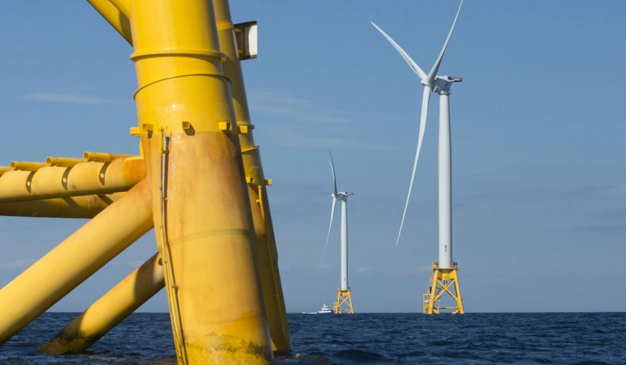 FILE - In this Aug. 15, 2016, file photo, wind turbines from the Deepwater Wind project stand in the sea off Block Island, R.I. The federal government holds a meeting Thursday, Dec. 12, 2019, at the University of New Hampshire in Durham, N.H., to discuss the potential for offshore wind in the Gulf of Maine. (AP Photo/Michael Dwyer, File)