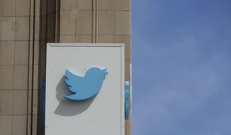 FILE - This July 9, 2019, file photo shows a sign outside of the Twitter office building in San Francisco. Twitter is bringing back special labels to help users identify accounts and tweets from U.S. political candidates. The company, which first used such labels for the midterms last year, said it is trying to provide users with original sources of information and prevent spoofed and fake accounts from fooling voters. (AP Photo/Jeff Chiu, File)