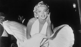 """In this Sept. 9, 1954 file photo, Marilyn Monroe poses over the updraft of a New York subway grate while filming """"The Seven Year Itch"""" New York. President Donald Trump has signed resolutions renaming two post offices in the Los Angeles area in honor of Monroe and rock 'n' roll legend Ritchie Valens. (AP Photo/Matty Zimmerman, File) **FILE**"""