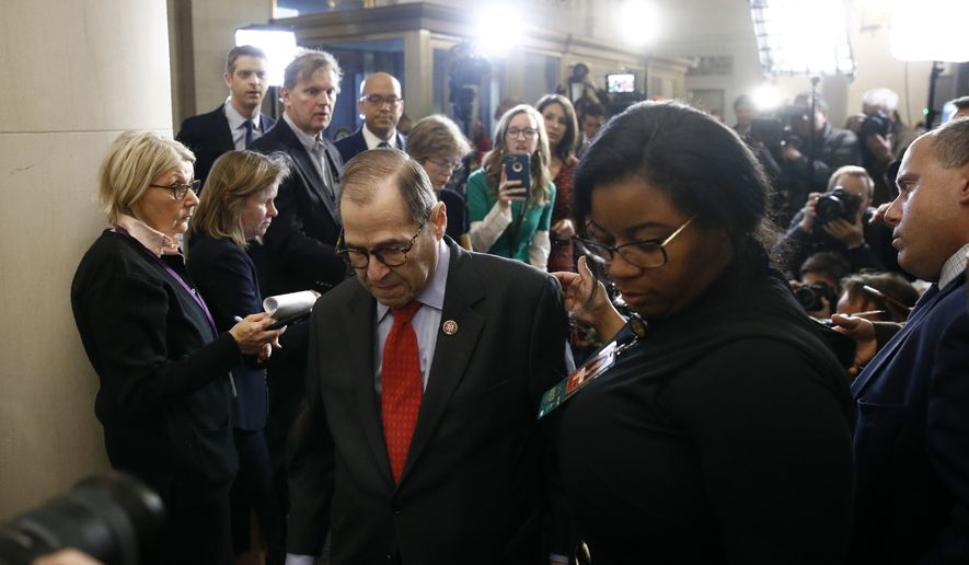 House Judiciary Committee Chairman Rep. Jerrold Nadler, D-N.Y., walks from the podium after the House Judiciary Committee approved the articles of impeachment against President Donald Trump, Friday, Dec. 13, 2019, on Capitol Hill in Washington. (AP Photo/Patrick Semansky)