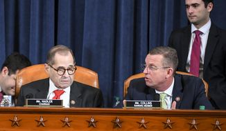 House Judiciary Committee ranking member Rep. Doug Collins, R-Ga., right, voices his displeasure after House Judiciary Committee Chairman Rep. Jerrold Nadler, D-N.Y., announced a recess at a House Judiciary Committee markup of the articles of impeachment against President Donald Trump, on Capitol Hill in Washington, Thursday, Dec. 12, 2019. Nadler announced a recess and that votes would occur on Friday morning. (Jonathan Newton/The Washington Post via AP, Pool)