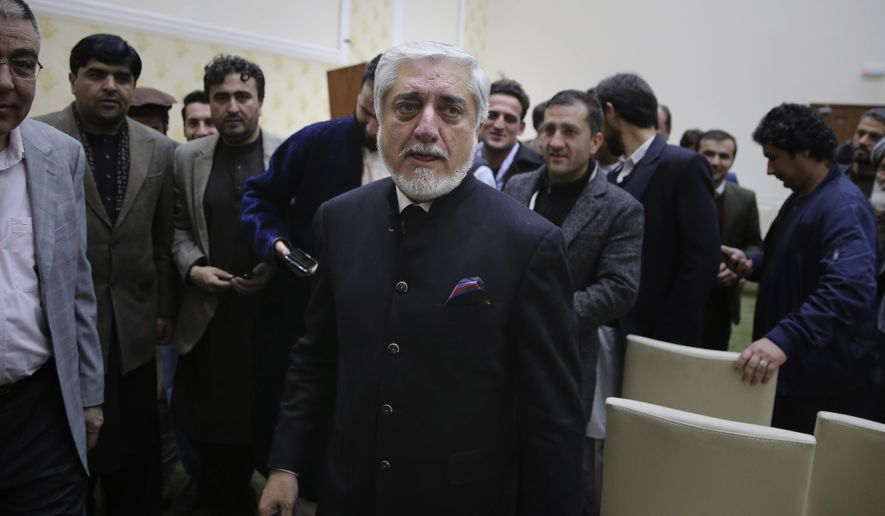 Afghan presidential candidate Abdullah Abdullah, leaves after addressing the media following a conference with his party members and few candidates in Kabul, Afghanistan, Friday, Dec. 13, 2019. Afghanistan's leading presidential candidate, Abdullah Abdullah, announced temporary truce, agreeing to allow ballot recount Sunday in provinces where his supporters had stopped the process for almost a month. (AP Photo/Altaf Qadri)