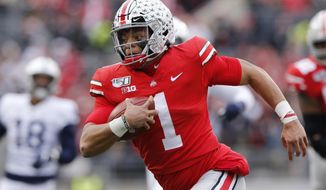 FILE - In this Nov. 23, 2019, file photo, Ohio State quarterback Justin Fields plays against Penn State during an NCAA college football game, in Columbus, Ohio. Fields was selected to The Associated Press All-Big Ten Conference football team, and named Big Ten Offensive Player of the Year Wednesday, Dec. 11, 2019. (AP Photo/Jay LaPrete, File)