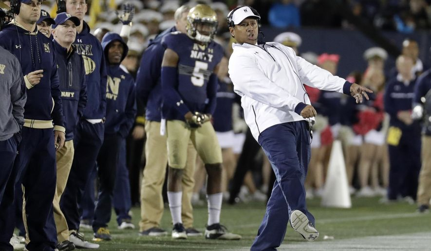 FILE - In this Oct. 22, 2016, file photo, Navy head coach Ken Niumatalolo, right, reacts as he watches a failed field goal-attempt in the second half of an NCAA college football game against Memphis, in Annapolis, Md. The 120th Army-Navy game is set for Saturday in Philadelphia.  Navy leads the series 60-52-7. (AP Photo/Patrick Semansky, File)  **FILE**
