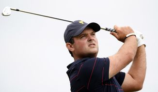 U.S. team player Patrick Reed hits on the 14th hole in their fourball match during the President's Cup golf tournament at Royal Melbourne Golf Club in Melbourne, Saturday, Dec. 14, 2019. (AP Photo/Andy Brownbill)