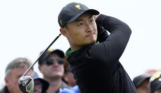 International team's Haotong Li of China tees off during a practice round ahead of the President's Cup Golf tournament in Melbourne, Wednesday, Dec. 11, 2019. (AP Photo/Andy Brownbill)