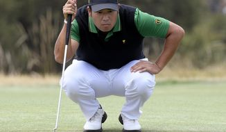 International team player Hideki Matsuyama of Japan looks over the 5th green in their foursomes match during the President's Cup golf tournament at Royal Melbourne Golf Club in Melbourne, Friday, Dec. 13, 2019. (AP Photo/Andy Brownbill)