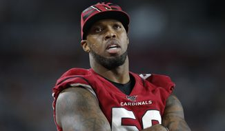FILE - In this Aug. 15, 2019, file photo, Arizona Cardinals linebacker Terrell Suggs watches during the second half of an NFL preseason football game against the Oakland Raiders in Glendale, Ariz. The Cardinals have released the veteran linebacker on Friday, Dec. 13, 2019, with three games remaining in a disappointing season for both the player and the team. (AP Photo/Ralph Freso, File)