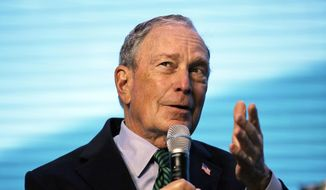 Democratic Presidential candidate and former New York City Mayor Michael Bloomberg gestures while taking part in an on-stage conversation with former California Gov. Jerry Brown at the American Geophysical Union fall meeting Wednesday, Dec. 11, 2019, in San Francisco. (AP Photo/Eric Risberg)