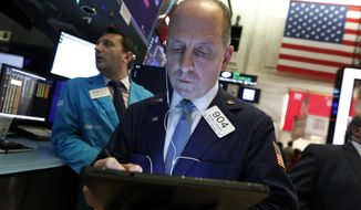 FILE - In this Dec. 5, 2019, file photo trader Michael Urkonis works on the floor of the New York Stock Exchange. The U.S. stock market opens at 9:30 a.m. EST on Friday, Dec. 13. (AP Photo/Richard Drew, File)