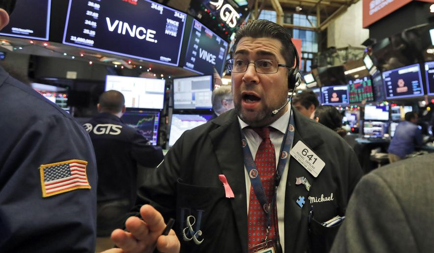 Trader Michael Capolino works on the floor of the New York Stock Exchange, Friday, Dec. 13, 2019. (AP Photo/Richard Drew) ** FILE **