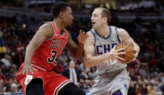 Charlotte Hornets center Cody Zeller, right, drives against Chicago Bulls center Wendell Carter Jr. during the first half of an NBA basketball game Friday, Dec. 13, 2019, in Chicago. (AP Photo/Nam Y. Huh)