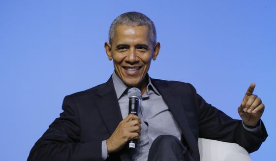"""Former U.S. President Barack Obama gesture as he attends the """"values-based leadership"""" during a plenary session of the Gathering of Rising Leaders in the Asia Pacific, organized by the Obama Foundation in Kuala Lumpur, Malaysia, Friday, Dec. 13, 2019. (AP Photo/Vincent Thian) ** FILE **"""