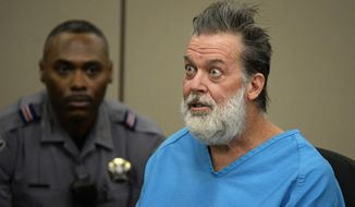 In this Dec. 9, 2015, file photo, Robert Lewis Dear talks to Judge Gilbert Martinez during a court appearance in Colorado Springs, Colo. Prosecutors are asking a judge to order a new mental evaluation for Dear who is accused of killing three people in a shooting at a Planned Parenthood clinic in Colorado. The request comes with Dear set to appear in U.S. District Court in Denver on Friday, Dec. 13, 2019, on new charges related to the 2015 Colorado Springs shooting. (Andy Cross/The Denver Post via AP, Pool, File) **FILE**