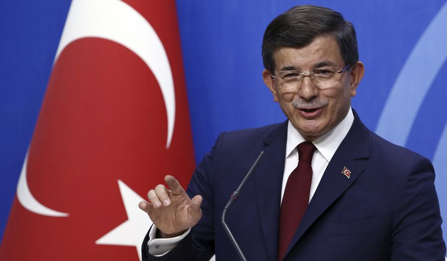 FILE - In this May 5, 2016 file photo, Prime Minister Ahmet Davutoglu speaks to the media, in Ankara, Turkey. Davutoglu, a former Turkish prime minister, who had served as foreign minister between 2009 and 2014 and later as prime minister until 2016, has established a new political party on Thursday, Dec. 12, 2019, in a move that could dent support for President Recep Tayyip Erdogan's ruling party. (AP Photo/Burhan Ozbilici, File)