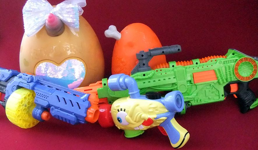 Gift ideas include Alpha Group' SpongeBob Giggle Blaster Hasbro's Zombie Strike Revoltinator, Zuru's X-Shot Ninja Turbo Strike, Rainbocorns Ultimate Surprise Egg and Dino Smashers Epic Egg (Photograph by Joseph Szadkowski / The Washington Times)