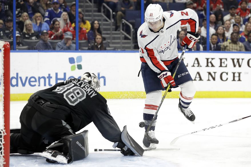 Washington Capitals right wing Garnet Hathaway (21) prepares to score on Tampa Bay Lightning goaltender Andrei Vasilevskiy (88) during the third period of an NHL hockey game Saturday, Dec. 14, 2019, in Tampa, Fla. (AP Photo/Chris O'Meara) ** FILE **
